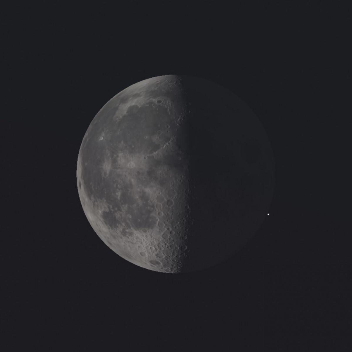 Een sterretje komt tevoorschijn vanachter de donkere maanrand